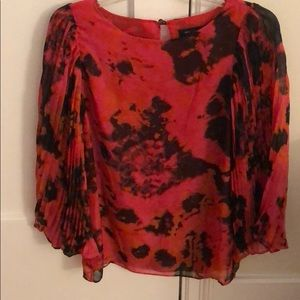 Pink tie-dye top with bell sleeves